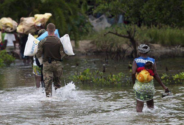 Photograph of people providing humanitarian aid.